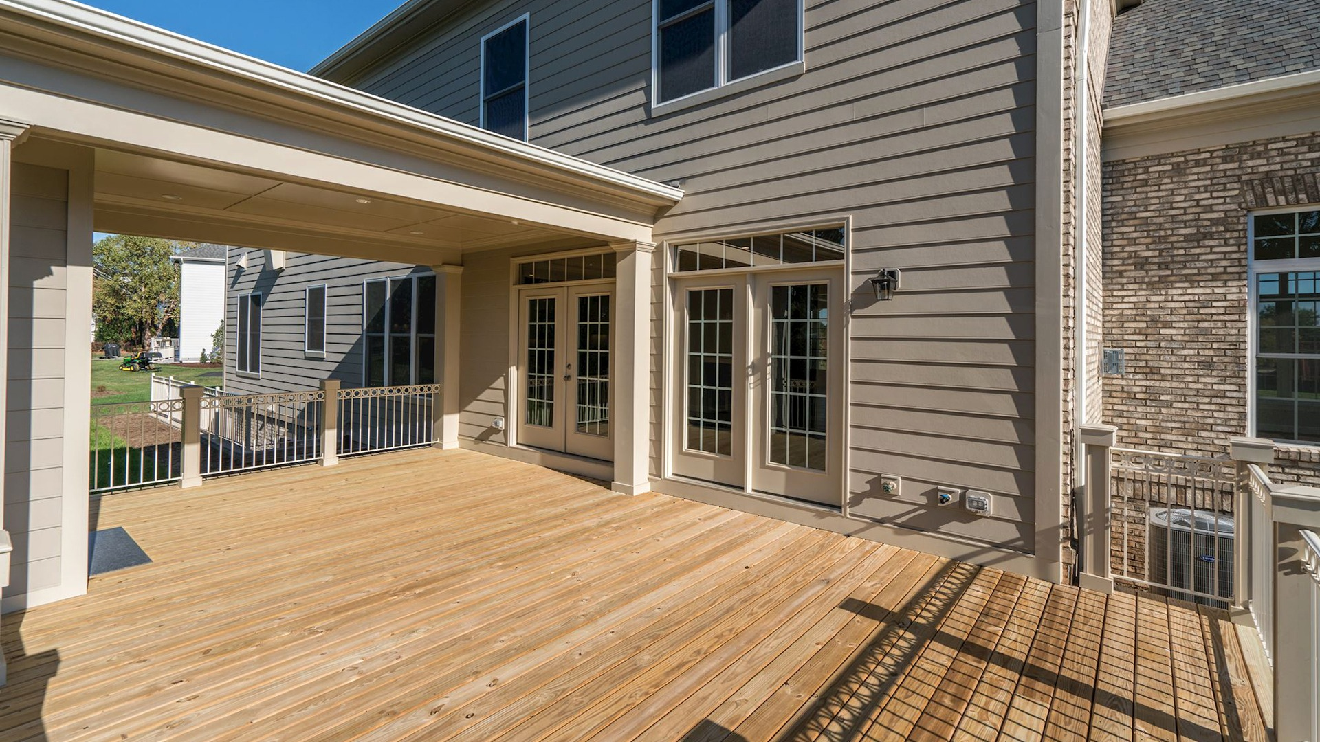 The deck and rear elevation of the Grayson on Fallsgate Homesite 4. Some optional features shown.
