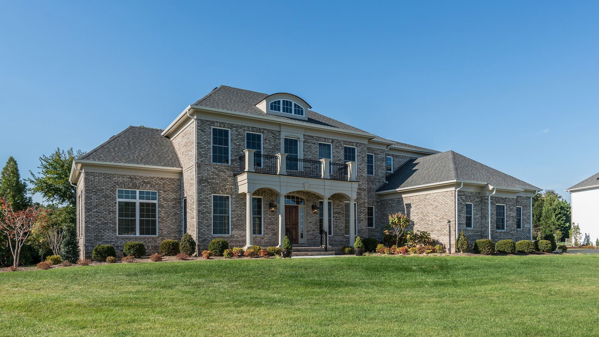 The front elevation of the Grayson on Fallsgate Homesite 4. Some optional features shown.