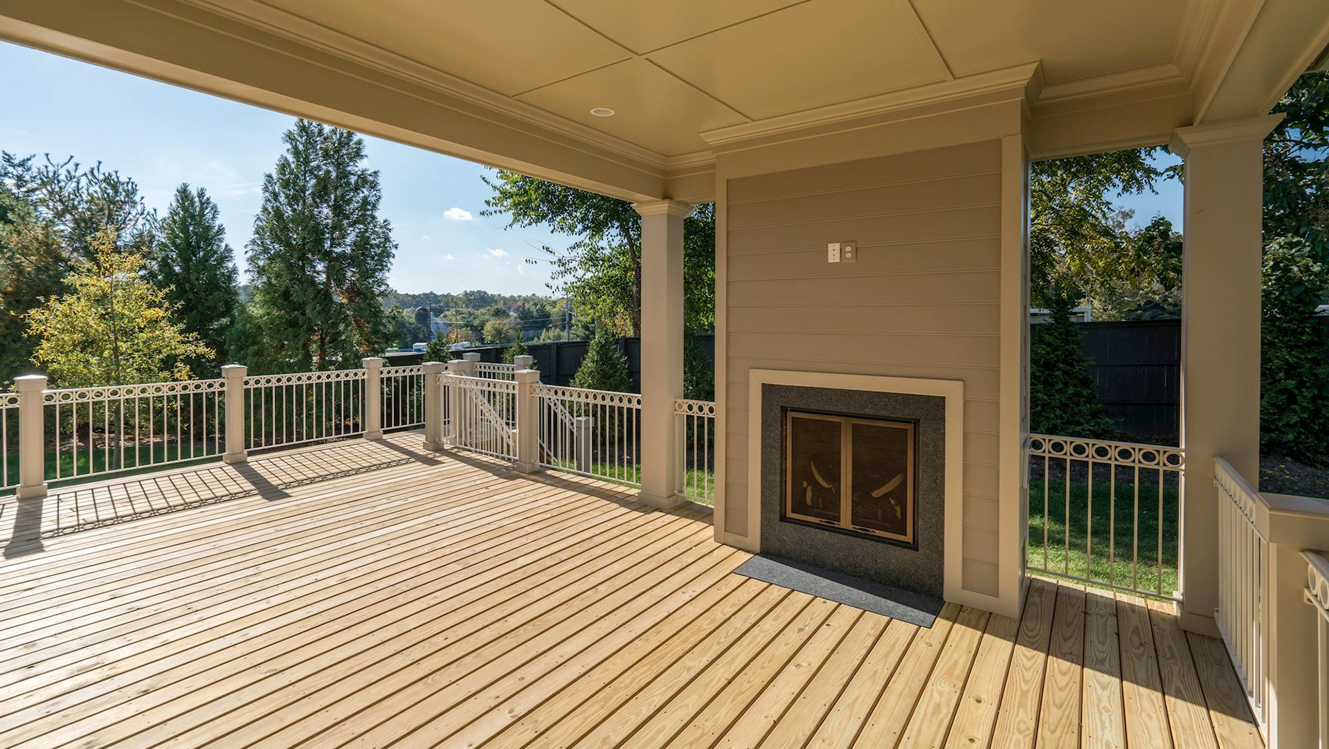 The Custom Lanai (covered deck) in the Grayson on Fallsgate Homesite 4. Some optional features shown.