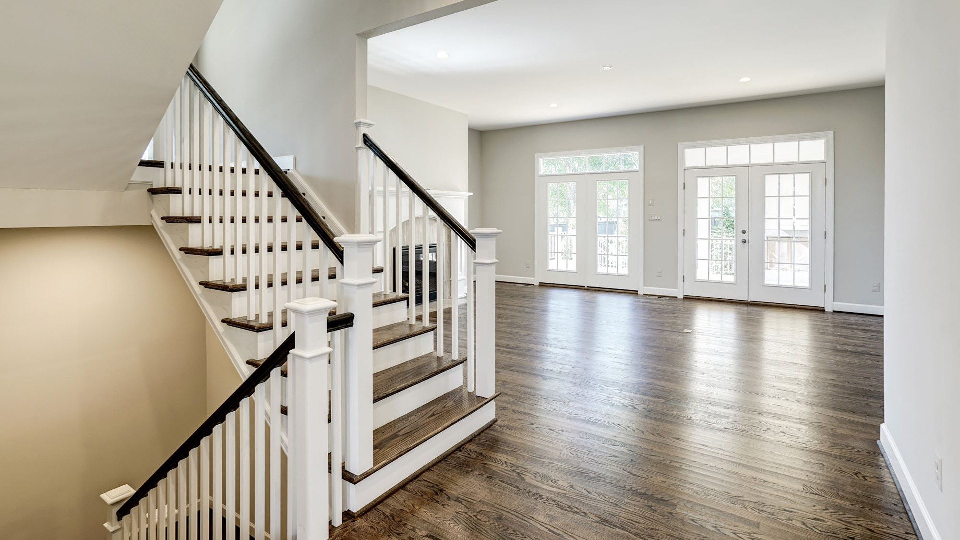 The open stair into the Family Room in the Grayson on Fallsgate Homesite 4. Some optional features shown.