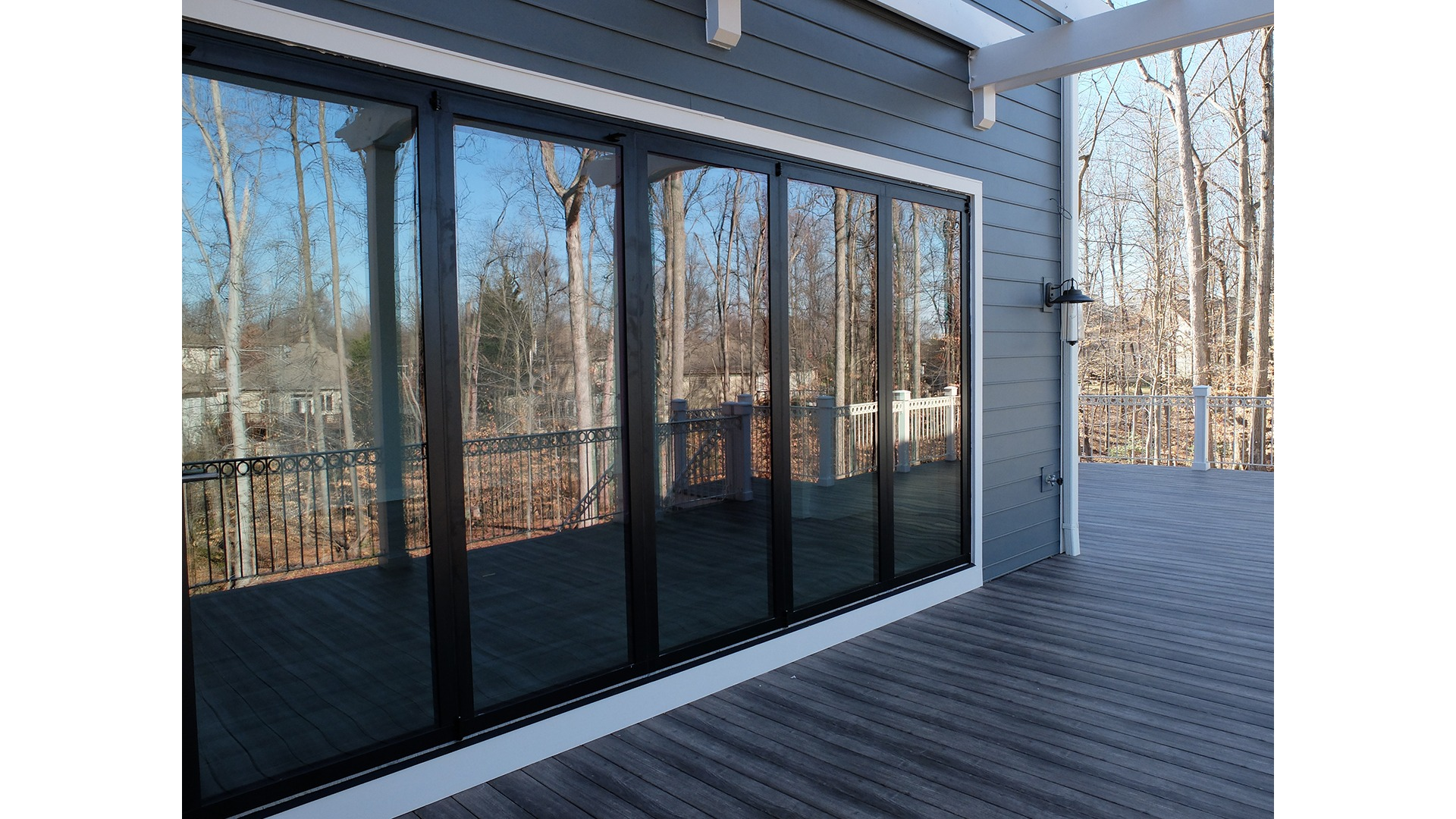 The opening rear wall creating indoor/outdor living in a Gulick   One semi-custom Grayson in Great Falls.