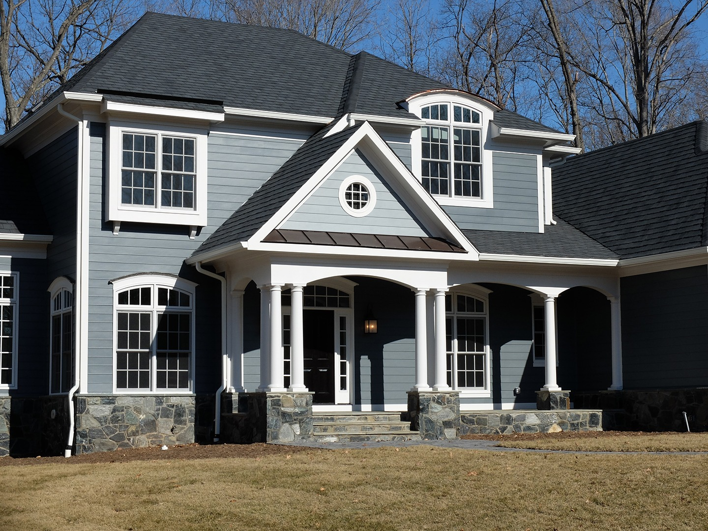 A custom front elevation on a Gulick | One semi-custom Grayson in Great Falls.