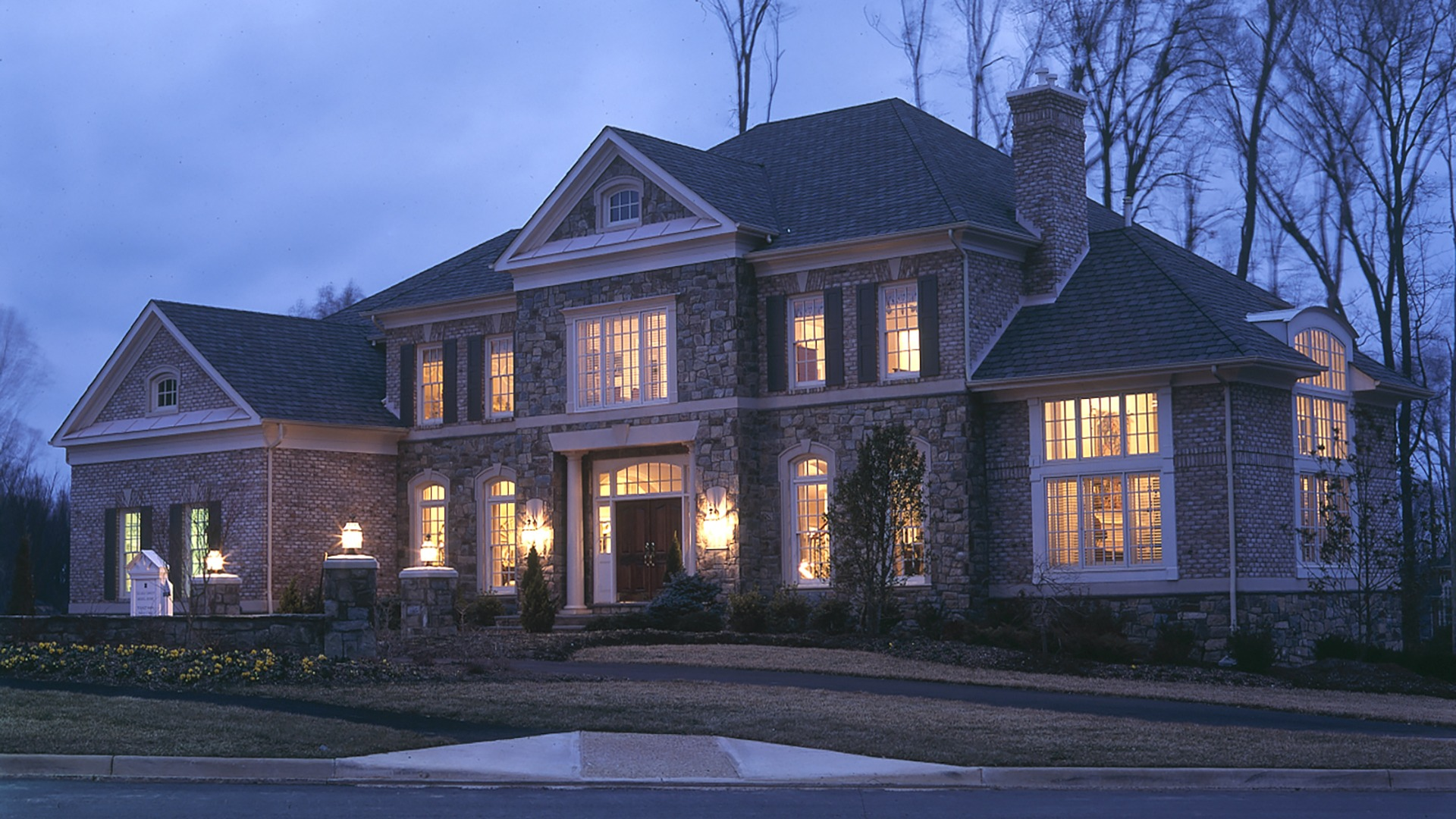 Woodley Front Elevation at dusk. Some optional features shown.