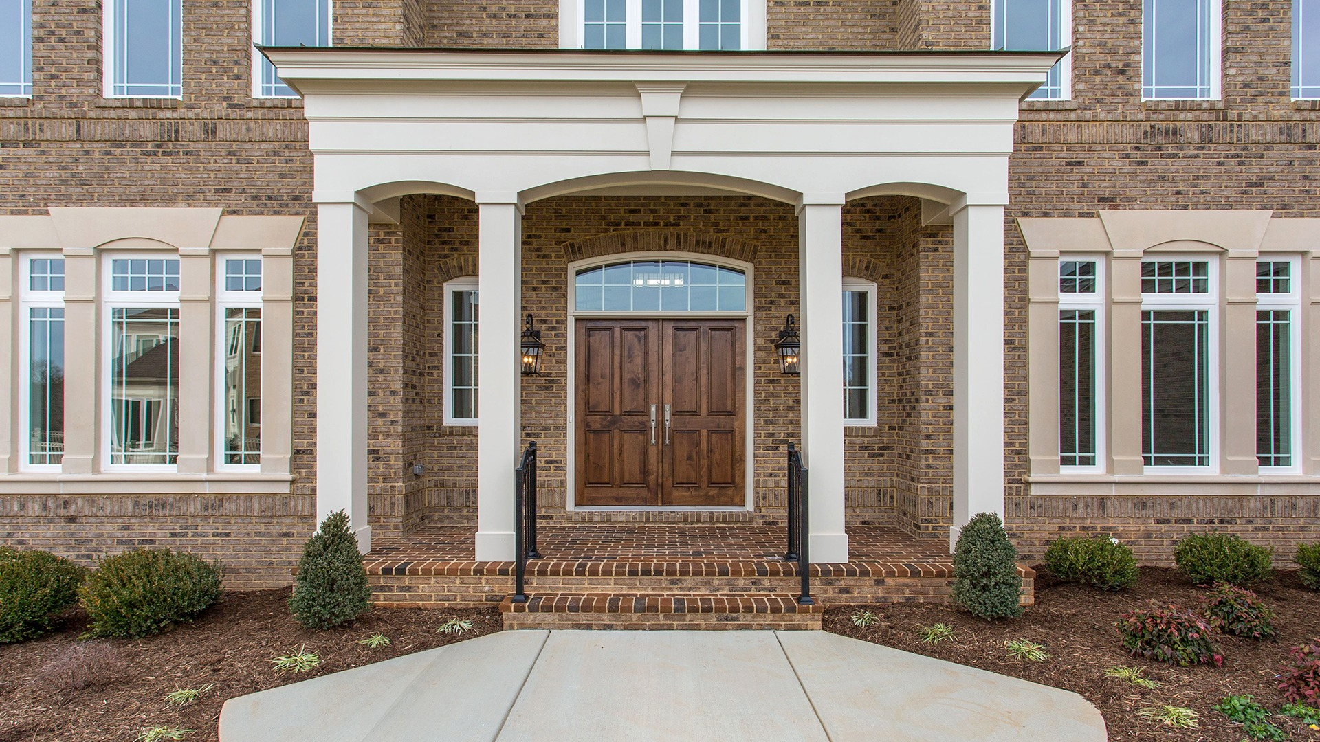 The front door of the Winthrop on Fallsgate Homesite 2. Some optional features shown.