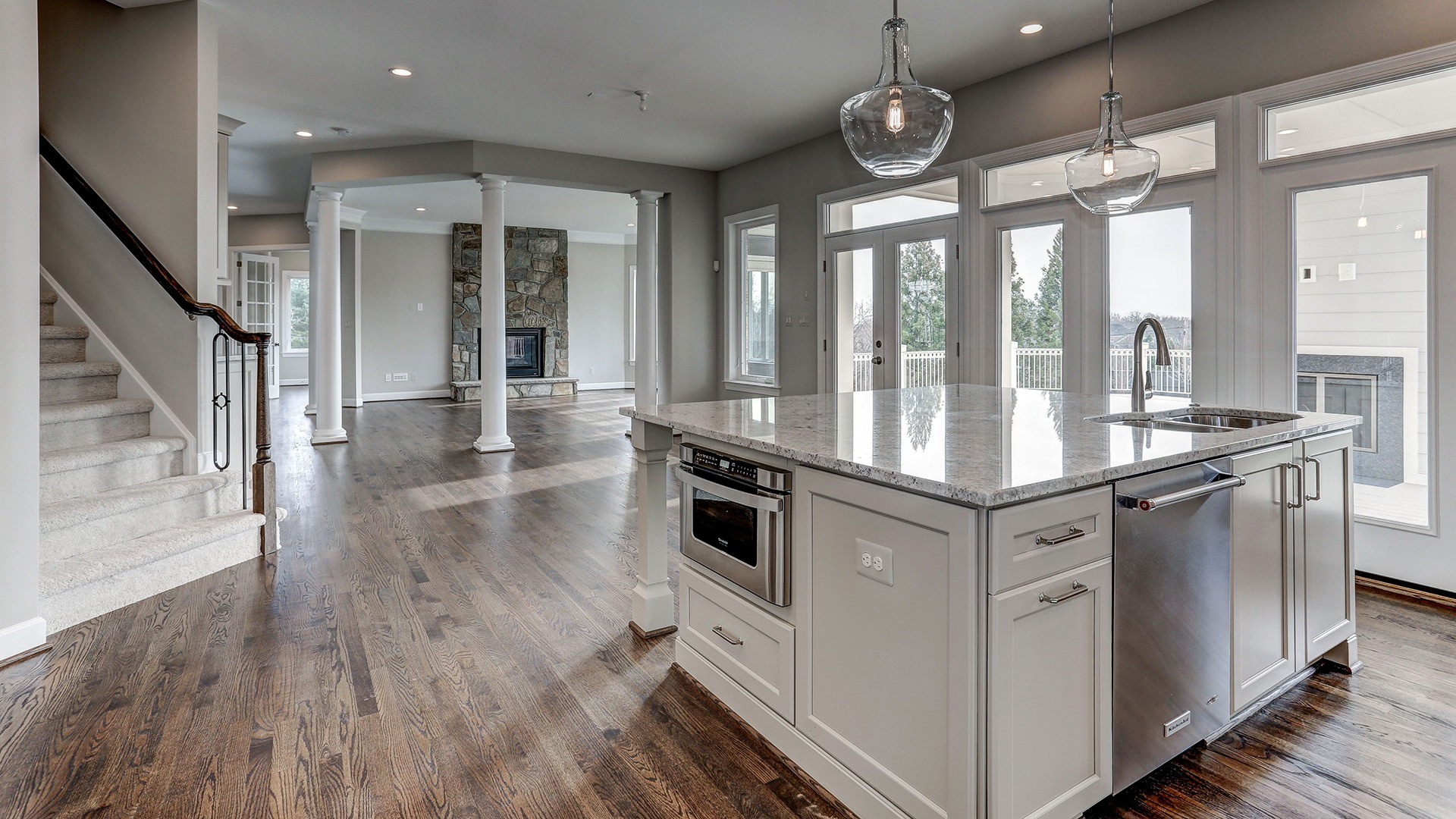 The sunlit, custom designer Kitchen in the Winthrop on Fallsgate Homesite 2. Some optional features shown.
