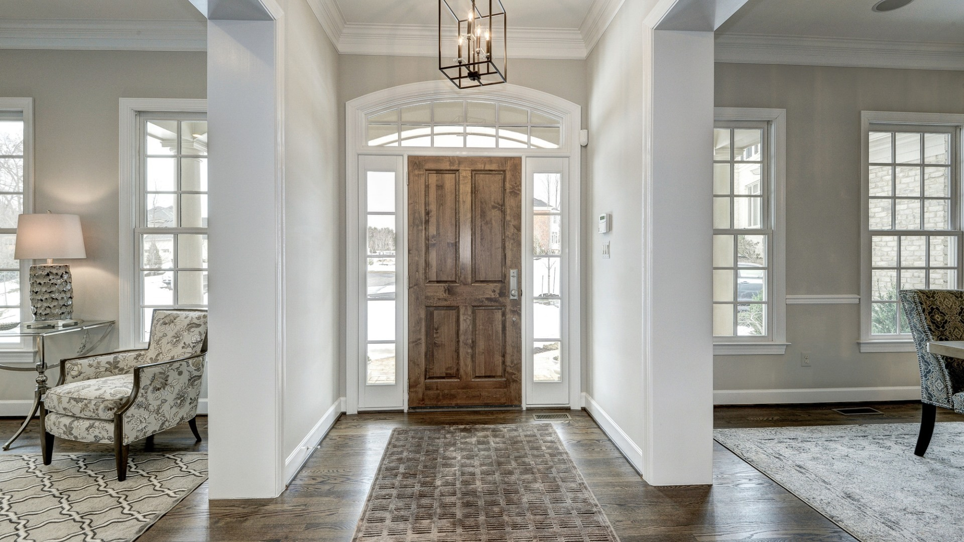 The foyer in a Grayson former model home, which may vary somewhat from the home planned at Vale Crest Homesite 5. Some optional features shown. Please see sales manager for details.