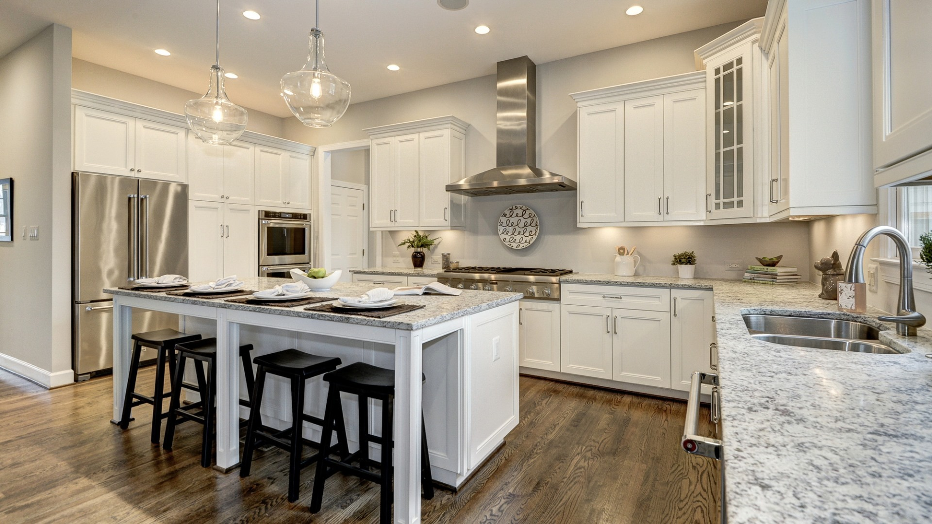 The gourmet kitchen in a Grayson former model home, which may vary somewhat from the home planned at Vale Crest Homesite 5. Some optional features shown. Please see sales manager for details.