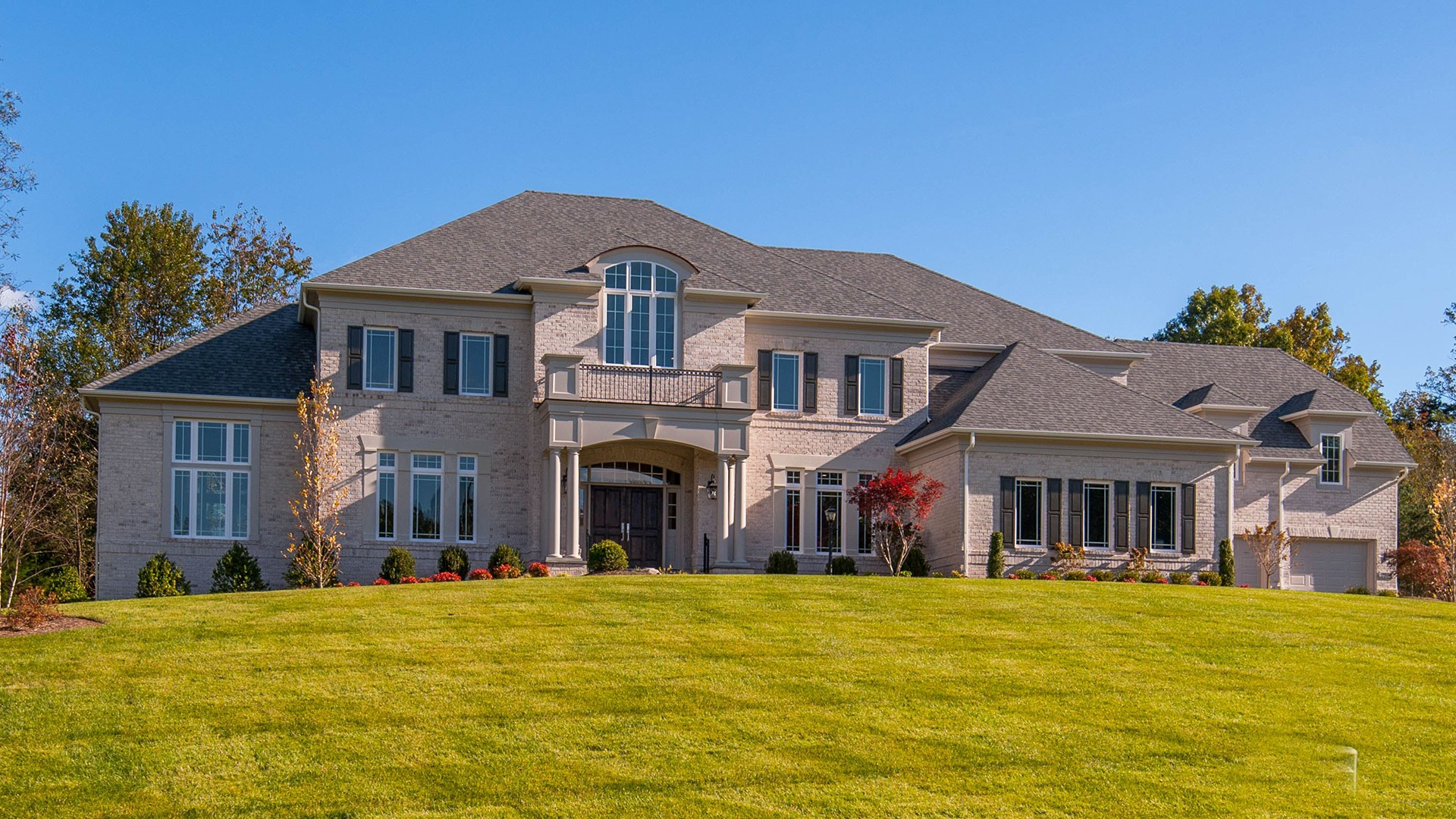 An all brick elevation with four car garage.