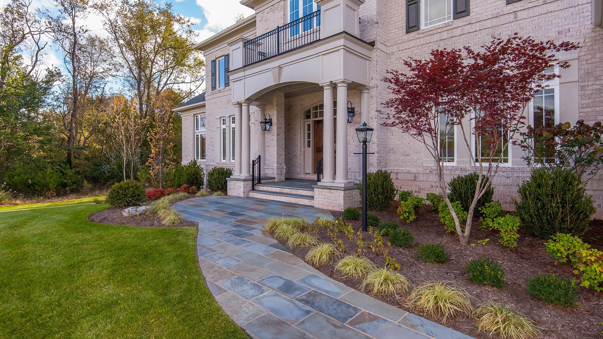 The stone leadwalk to the impressive front doors.