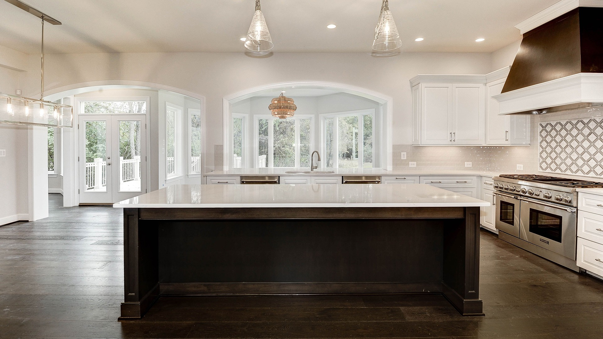 A revised Kitchen with open plan to a naturally lit Sun/Morning Room.