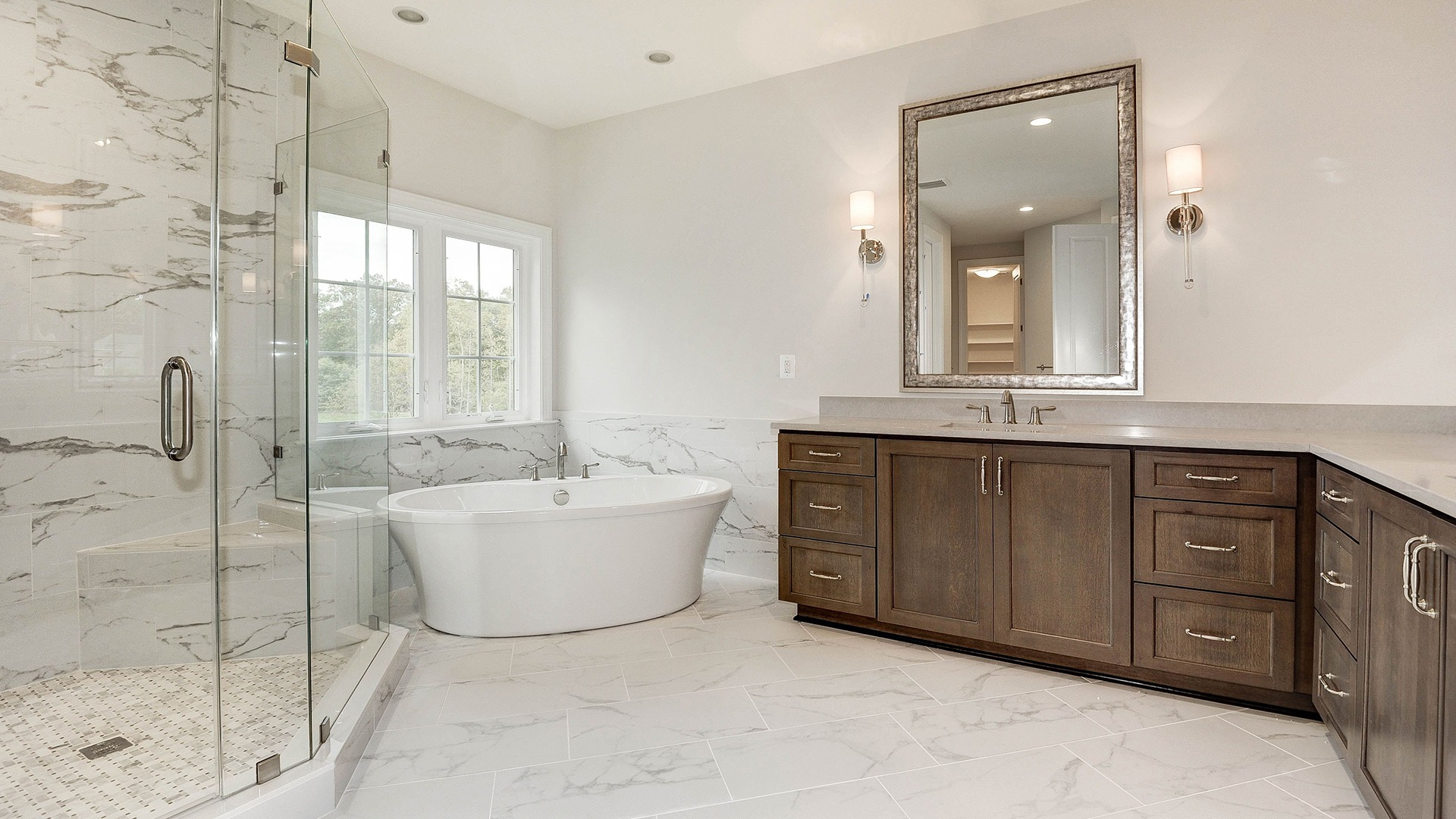 Luxury Owner's Bath with free-standing tub and frameless shower