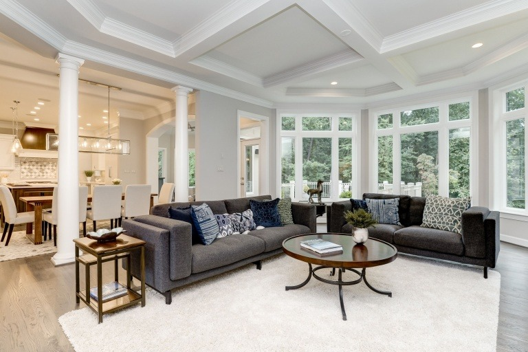 A sunlit Family Room, with trimmed box beam ceiling, looking into the gourmet Kitchen in the Gulick Group Winthrop, one of the planned homes at Summer Creek. Some optional features shown.