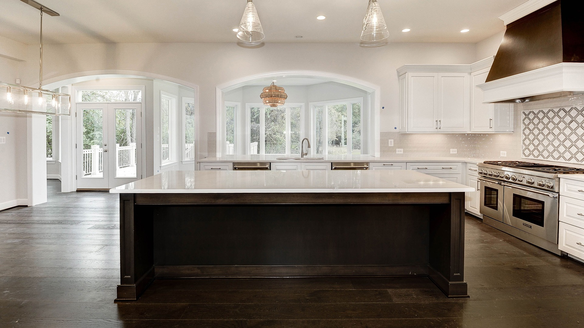 The dramatic sunlit opening between the Optional Sunroom and Kitchen in the Summerwood Series Winthrop