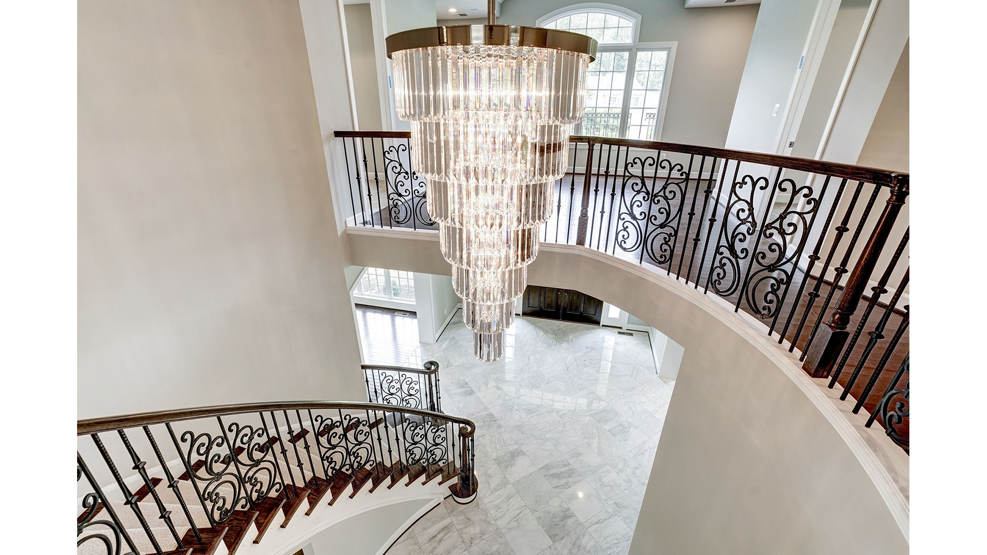 The dramatic, central chandelier in a Gulick | One custom home.