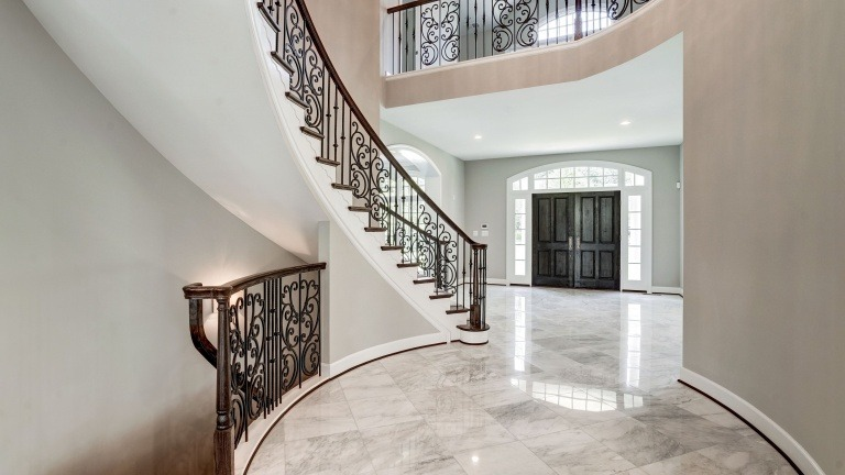 The large format tile in the dramatic foyer of a Gulick | One custom home.