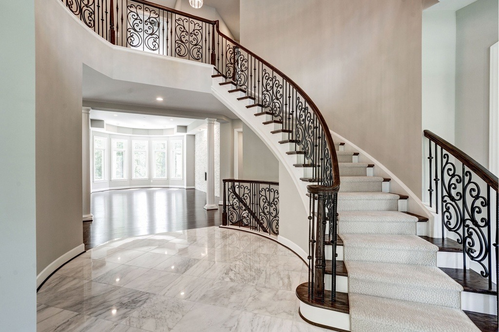 Large format tile in the dramatic Foyer in a Gulick | One custom home.