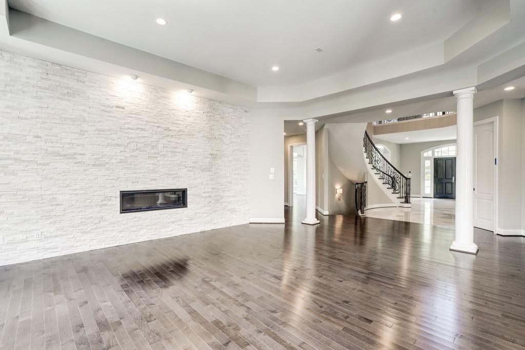 Horizontal Fireplace with Ledger Stone Surround