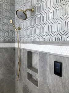 A shower with patterned tile.