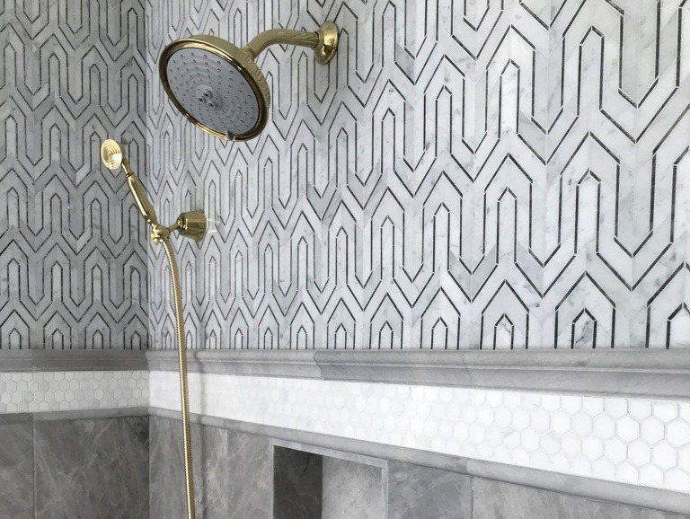 A shower having patterned tile, summary size.