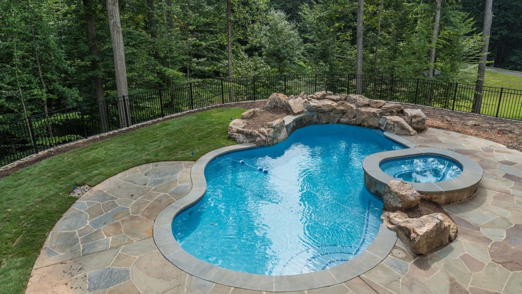 This pool was built on a lot with a lot of slope, and has a beautiful view.